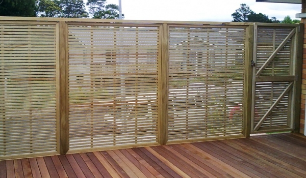 Pine trellis privacy screen with gate.