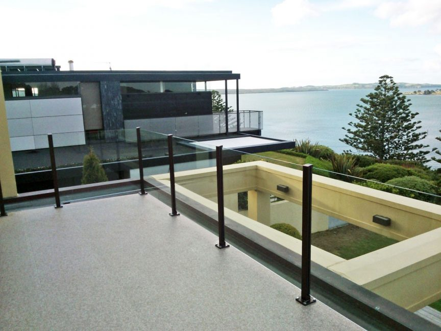 PVC vinyl deck with glass balustrade and aluminum posts.