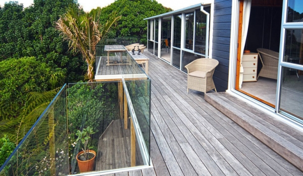 Pine deck with frameless glass balustrades.