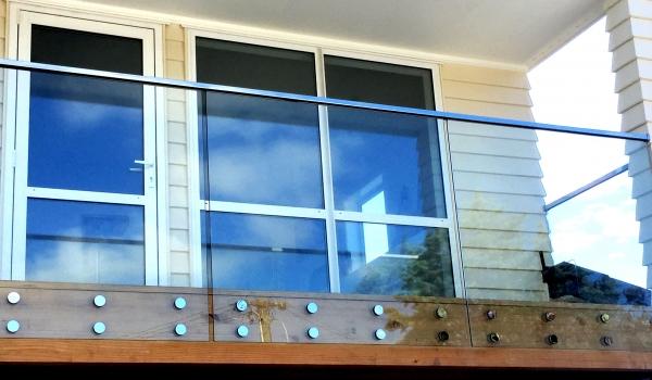 Glass balustrade with top rail.