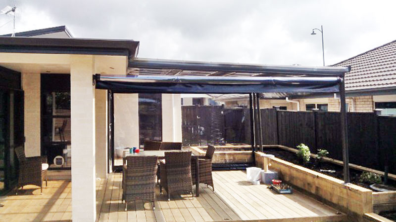Clear outdoor roller blinds.