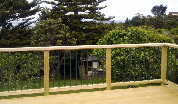 Timber deck railing with aluminum balusters.